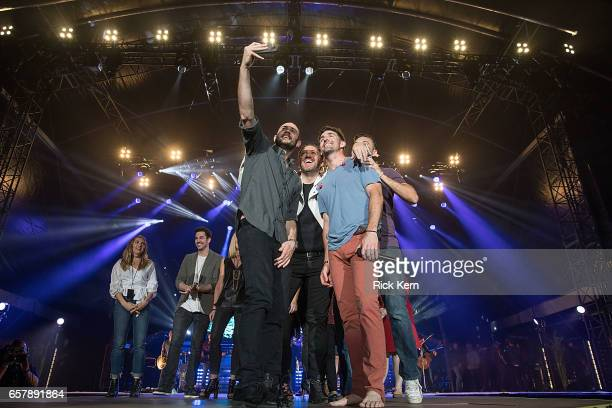 Jake Owen welcomes members from the American Heart Association American Cancer Society and MakeAWish Foundation to the stage for a curtain call...