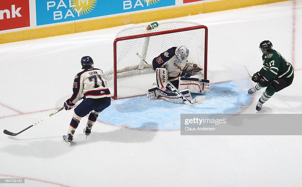 <a gi-track='captionPersonalityLinkClicked' href=/galleries/search?phrase=Jake+Paterson&family=editorial&specificpeople=196523 ng-click='$event.stopPropagation()'>Jake Paterson</a> #57 of the Saginaw Spirit stops a scoring attempt by Seth Griffith #17 of the London Knights in a first round playoff game on March 24, 2013 at the Budweiser Gardens in London, Ontario, Canada. The Knights defeated the Spirit 3-2 in double overtime to take a 2-0 series lead.