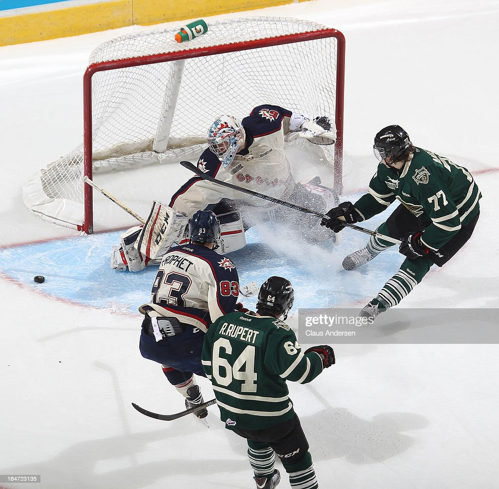 <a gi-track='captionPersonalityLinkClicked' href=/galleries/search?phrase=Jake+Paterson&family=editorial&specificpeople=196523 ng-click='$event.stopPropagation()'>Jake Paterson</a> #57 of the Saginaw Spirit turns a scoring attempt by Josh Anderson #77 of the London Knights away in a first round playoff game on March 24, 2013 at the Budweiser Gardens in London, Ontario, Canada. The Knights defeated the Spirit 3-2 in double overtime to take a 2-0 series lead.