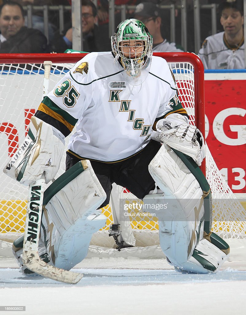 Jake Patterson #35 of the London Knights watches for a shot against the Erie Otters during an OHL game at the Budweiser Gardens on October 25, 2013 in London, Ontario, Canada. The Otters defeated the Knights 5-1.