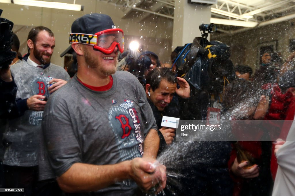 <a gi-track='captionPersonalityLinkClicked' href=/galleries/search?phrase=Jake+Peavy&family=editorial&specificpeople=211320 ng-click='$event.stopPropagation()'>Jake Peavy</a> #44 of the Boston Red Sox celebrates in the locker room after defeating the St. Louis Cardinals 6-1 in Game Six of the 2013 World Series at Fenway Park on October 30, 2013 in Boston, Massachusetts.