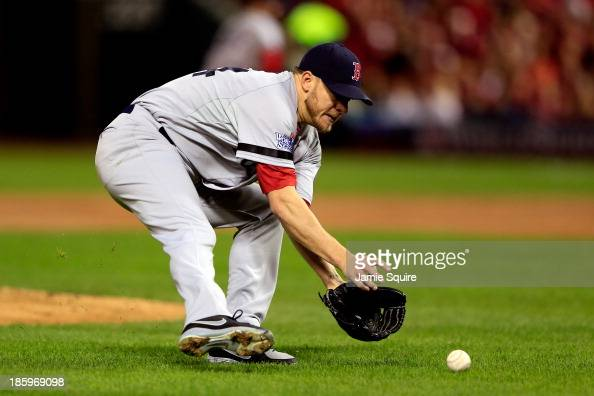 Jake Peavy of the Boston Red Sox fields a sacrafice bunt by Carlos Beltran of the St Louis Cardinals in the first inning of Game Three of the 2013...