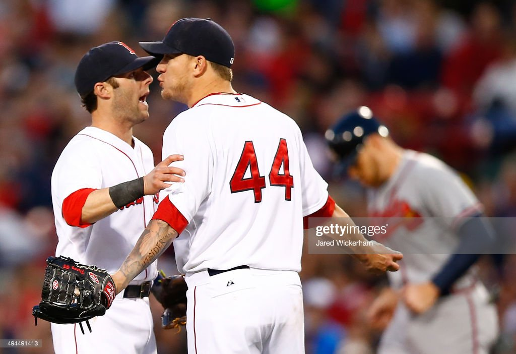 <a gi-track='captionPersonalityLinkClicked' href=/galleries/search?phrase=Jake+Peavy&family=editorial&specificpeople=211320 ng-click='$event.stopPropagation()'>Jake Peavy</a> #44 of the Boston Red Sox is held back by teammate <a gi-track='captionPersonalityLinkClicked' href=/galleries/search?phrase=Dustin+Pedroia&family=editorial&specificpeople=836339 ng-click='$event.stopPropagation()'>Dustin Pedroia</a> #15 during an argument with umpire Bob Davidson in the fourth inning against the Atlanta Braves during the game at Fenway Park on May 29, 2014 in Boston, Massachusetts.