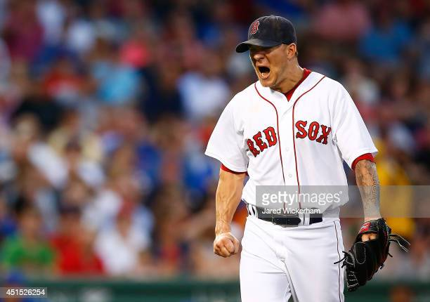 Jake Peavy of the Boston Red Sox reacts after giving up a tworun home run in the fourth inning against the Chicago Cubs during the interleague game...