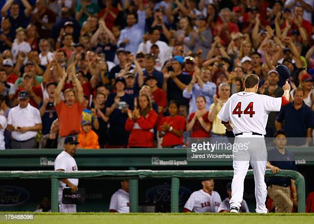 Jake Peavy of the Boston Red Sox tips his hat and acknowledges the crowd while receiving a standing ovation after being pulled from the game in the...