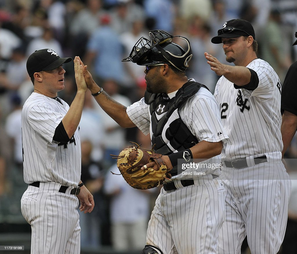 Jake Peavy # 44 (L), of the Chicago White Sox congratulates Ramon Castro #27 (C) and A.J. Pierzynsk #14 after the White Sox victory against the Washington Nationals on June 25, 2011 at U.S. Cellular Field in Chicago, Illinois. The White sox defeated the Nationals 3-0.