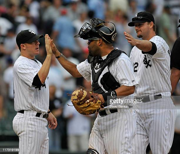 Jake Peavy of the Chicago White Sox congratulates Ramon Castro and AJ Pierzynsk after the White Sox victory against the Washington Nationals on June...