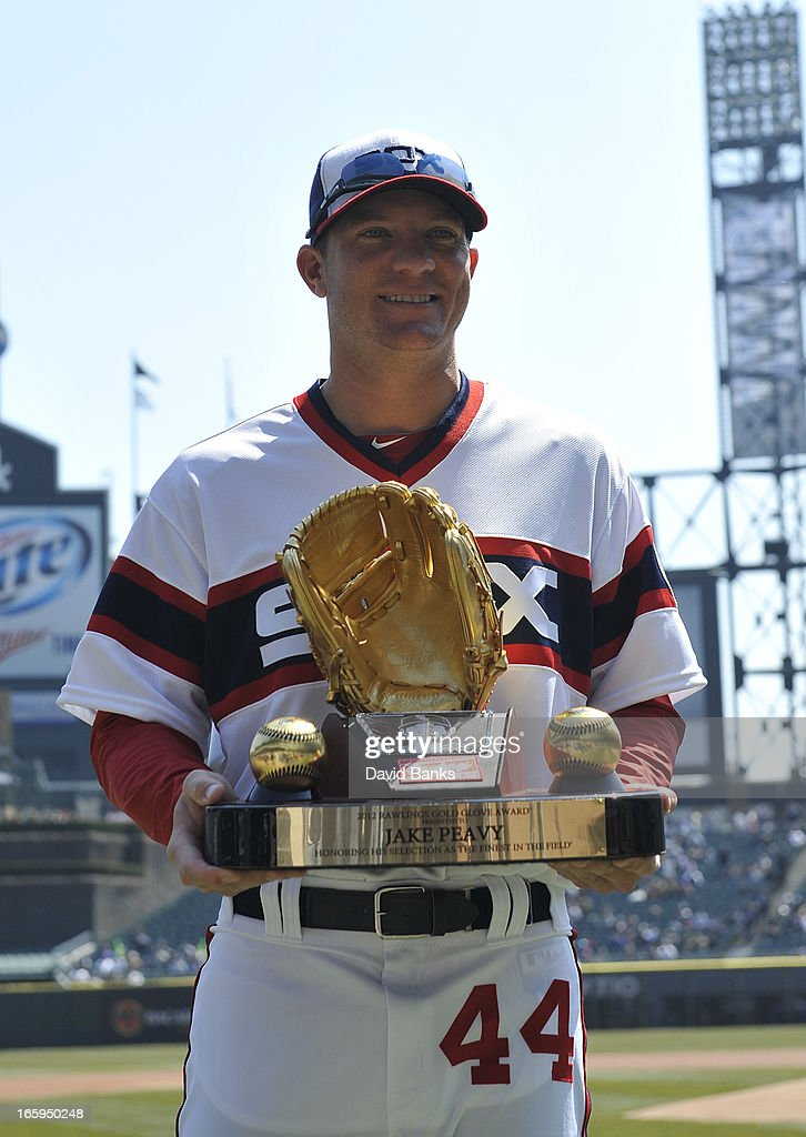 Jake Peavy #44 of the Chicago White Sox holds 2012 Rawlings Gold Glove award presented to hi before the game between the Chicago White Sox and the Seattle Mariners on April 7, 2013 at U.S. Cellular Field in Chicago, Illinois.