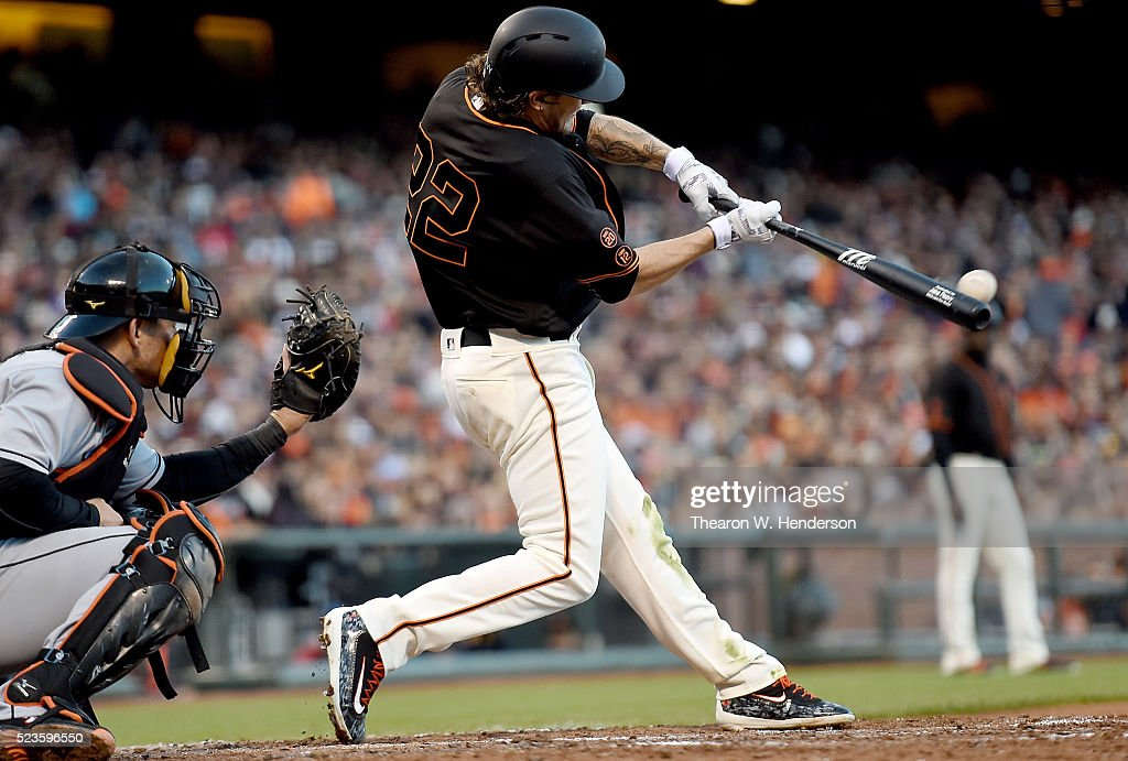 <a gi-track='captionPersonalityLinkClicked' href=/galleries/search?phrase=Jake+Peavy&family=editorial&specificpeople=211320 ng-click='$event.stopPropagation()'>Jake Peavy</a> #22 of the San Francisco Giants hits a bases loaded two-run rbi single against the Miami Marlins in the bottom of the fourth inning at AT&T Park on April 23, 2016 in San Francisco, California.