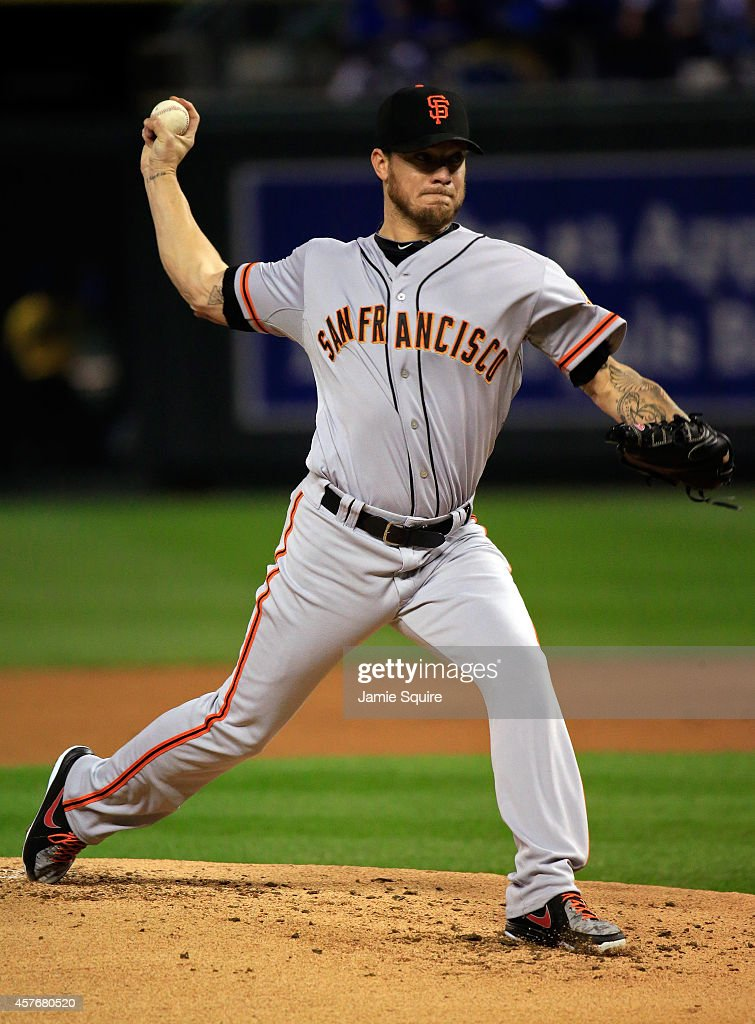 <a gi-track='captionPersonalityLinkClicked' href=/galleries/search?phrase=Jake+Peavy&family=editorial&specificpeople=211320 ng-click='$event.stopPropagation()'>Jake Peavy</a> #22 of the San Francisco Giants pitches against the Kansas City Royals in the first inning during Game Two of the 2014 World Series at Kauffman Stadium on October 22, 2014 in Kansas City, Missouri.