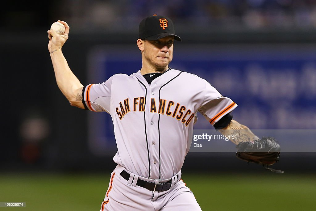 <a gi-track='captionPersonalityLinkClicked' href=/galleries/search?phrase=Jake+Peavy&family=editorial&specificpeople=211320 ng-click='$event.stopPropagation()'>Jake Peavy</a> #22 of the San Francisco Giants pitches in the first inning against the Kansas City Royals during Game Six of the 2014 World Series at Kauffman Stadium on October 28, 2014 in Kansas City, Missouri.