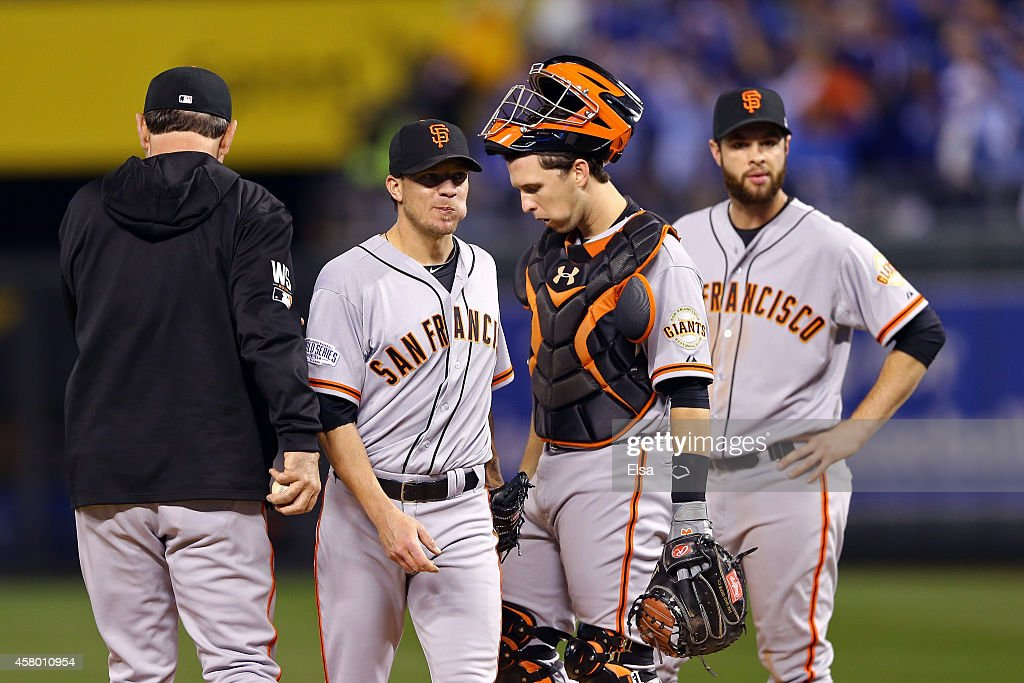 Jake Peavy #22 of the San Francisco Giants walks to the dugout after getting pulled from the game in the second inning as manager Bruce Bochy #15, Buster Posey #28 and Brandon Belt #9 stand on the mound during Game Six of the 2014 World Series against the Kansas City Royals at Kauffman Stadium on October 28, 2014 in Kansas City, Missouri.