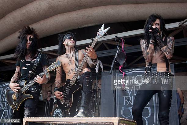 Jake Pitts Ashley Purdy and Andy 'Six' Biersack of Black Veil Brides performs onstage during the 2011 Vans Warped Tour at the Marcus Amphitheater on...