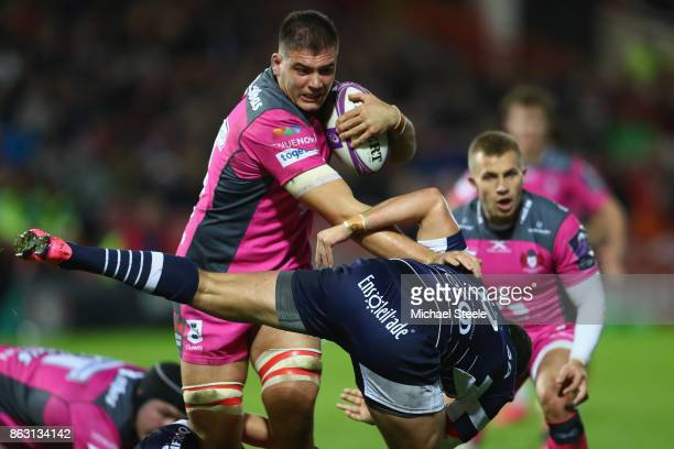 Jake Polledri of Gloucester powers past Clement Martinez of Agen during the European Rugby Challenge Cup Pool 3 match between Gloucester and Agen at...