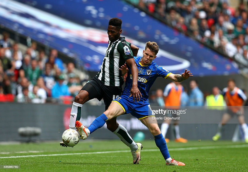 Jake Reeves (R) of AFC Wimbledon challenges Jamille Matt of Plymouth to the ball during the Sky Bet League 2 Play Off Final between Plymouth Argyle and AFC Wimbledon at Wembley Stadium on May 30, 2016 in London, England.