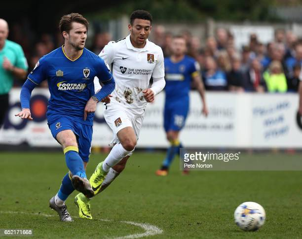 Jake Reeves of AFC Wimbledon in action during the Sky Bet League One match between AFC Wimbledon and Northampton Town at The Cherry Red Records...