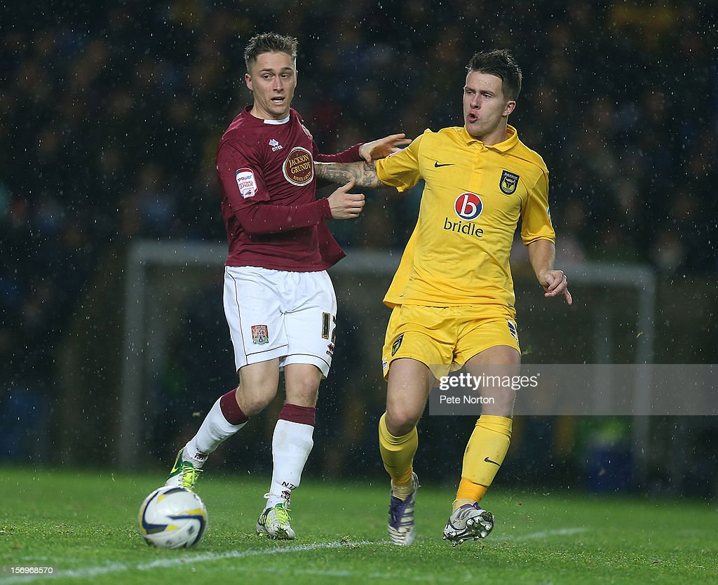 Jake Robinson of Northampton Town looks for the ball with Lee Cox of Oxford United during the npower League Two match between Oxford United and Northampton Town at Kassam Stadium on November 24, 2012 in Oxford, England.