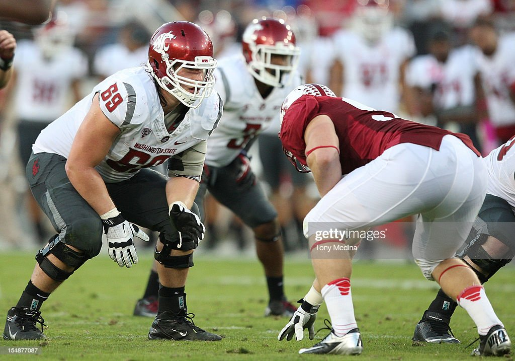 Jake Rodgers #69 of the Washington State Cougars lines up across from a Stanford Cardinal while waiting for the ball to be snapped at Stanford Stadium on October 27, 2012 in Palo Alto, California.