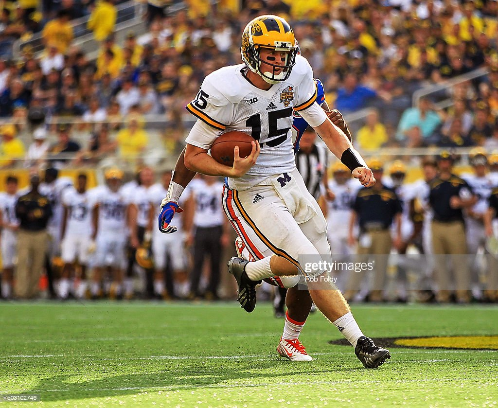 Jake Rudock #15 of the Michigan Wolverines rushes for a first down during the second half of the Buffalo Wild Wings Citrus Bowl game against the Florida Gators at Orlando Citrus Bowl on January 1, 2016 in Orlando, Florida.