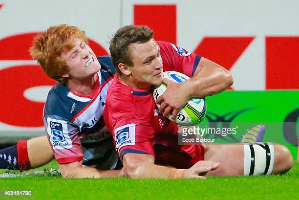 Jake Schatz of the Reds scores a try during the round eight Super Rugby match between the Rebels and the Reds at AAMI Park on April 3 2015 in...