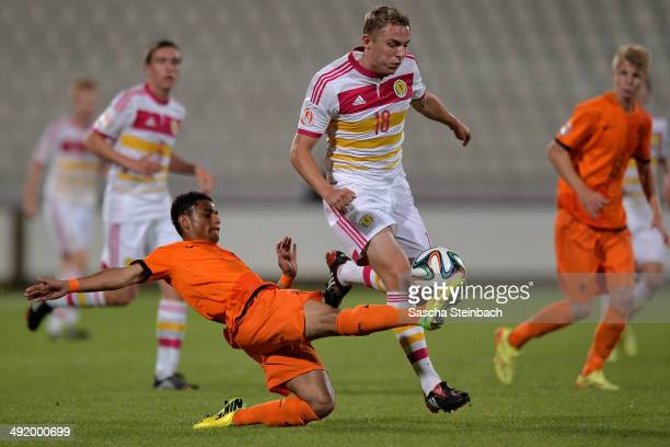 Jake Sheppard of Scotland is challenged by Wellington Verloo of Netherlands during the UEFA Under17 European Championship 2014 semi final match...