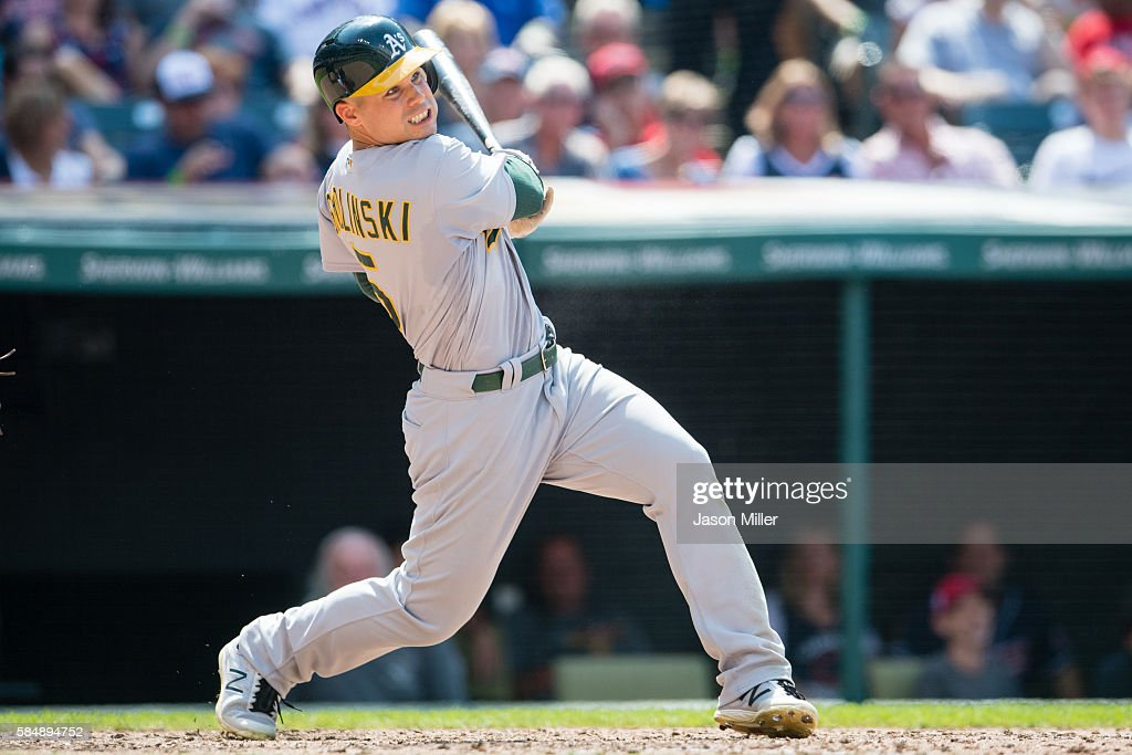 Jake Smolinski of the Oakland Athletics hits a double during the sixth inning against the Cleveland Indians at Progressive Field on July 31 2016 in...
