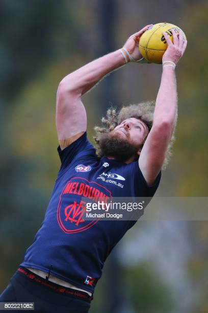 Jake Spencer gathers the ball during a Melbourne Demons AFL training session at Gosch's Paddock on June 28 2017 in Melbourne Australia