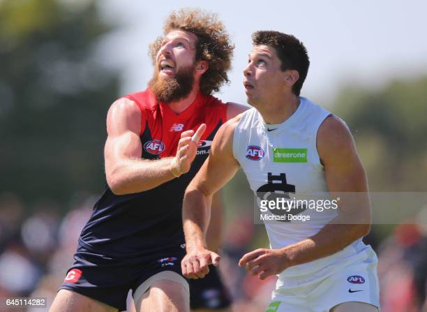 Jake Spencer of the Blues and Matthew Kreuzer of the Blues compete for the ball during the JLT Community Series AFL match between the Melbourne...