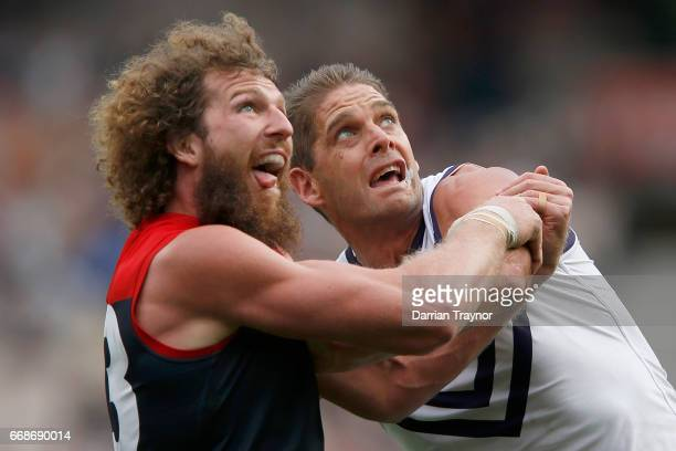 Jake Spencer of the Demons and Aaron Sandilands of the Dockers compete in the ruck during the round four AFL match between the Melbourne Demons and...