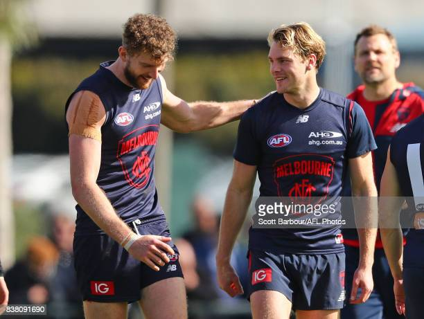 Jake Spencer of the Demons and Jack Watts of the Demons talk during a Melbourne Demons AFL training session at Gosch's Paddock on August 24 2017 in...