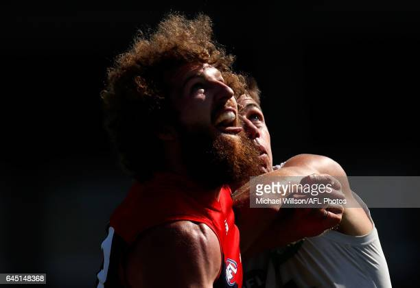 Jake Spencer of the Demons and Matthew Kreuzer of the Blues compete in a ruck contest during the AFL 2017 JLT Community Series match between the...