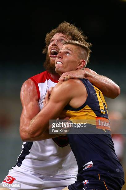 Jake Spencer of the Demons and Nathan Vardy of the Eagles contest a boundary throw in during the JLT Community Series AFL match between the West...