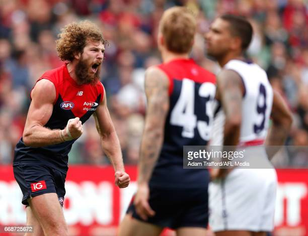 Jake Spencer of the Demons celebrates a goal during the 2017 AFL round 04 match between the Melbourne Demons and the Fremantle Dockers at the...