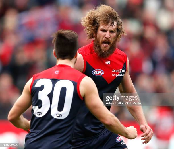 Jake Spencer of the Demons celebrates a goal with Alex NealBullen of the Demons during the 2017 AFL round 04 match between the Melbourne Demons and...