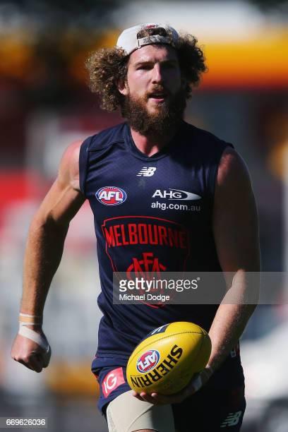 Jake Spencer of the Demons handballs during a Melbourne Demons AFL training session at Gosch's Paddock on April 18 2017 in Melbourne Australia
