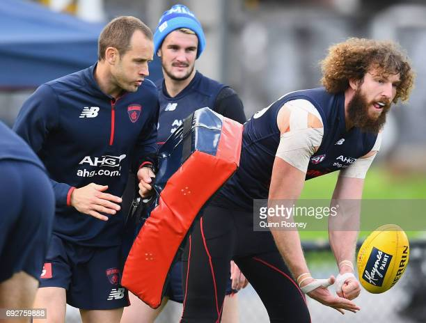 Jake Spencer of the Demons handballs during a Melbourne Demons AFL training session at Gosch's Paddock on June 6 2017 in Melbourne Australia