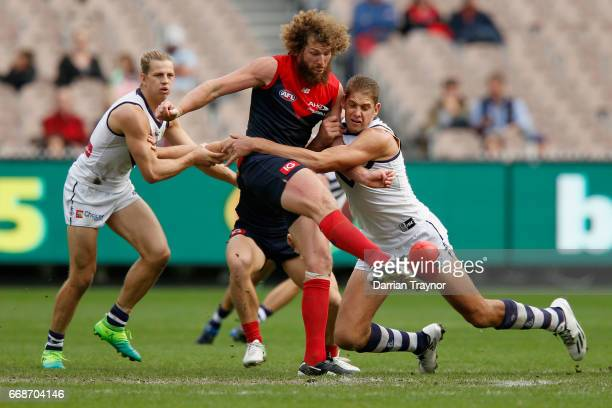 Jake Spencer of the Demons kicks the ball during the round four AFL match between the Melbourne Demons and the Fremantle Dockers at Melbourne Cricket...