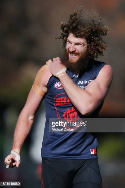 Jake Spencer of the Demons looks in discomfort with his shoulder during a Melbourne Demons AFL training session at Gosch's Paddock on July 25 2017 in...