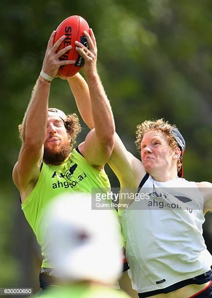 Jake Spencer of the demons marks during a Melbourne Demons AFL training session at Gosch's Paddock on December 16 2016 in Melbourne Australia