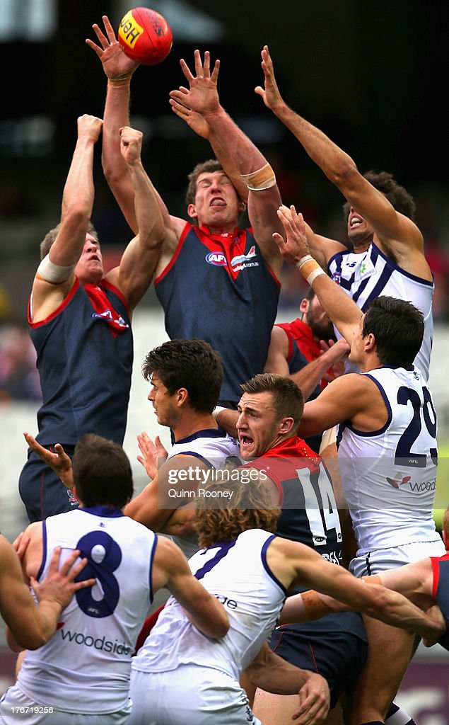 Jake Spencer of the Demons marks during the round 21 AFL match between the Melbourne Demons and the Fremantle Dockers at Melbourne Cricket Ground on August 18, 2013 in Melbourne, Australia.
