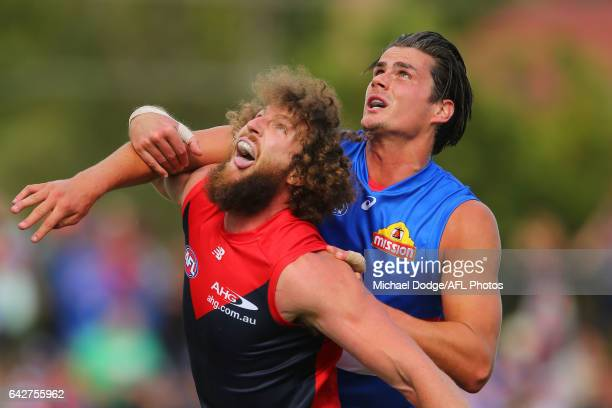 Jake Spencer of the Demons Tom Boyd of the Bulldogs compete for the ball during the 2017 JLT Community Series match between the Western Bulldogs and...