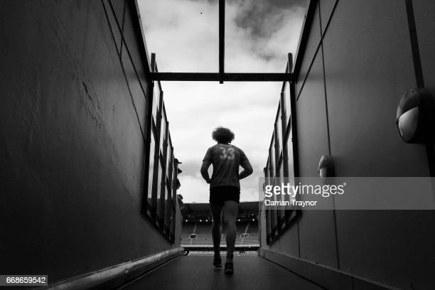 Jake Spencer of the Demons walks up the race to warm up before the round four AFL match between the Melbourne Demons and the Fremantle Dockers at...