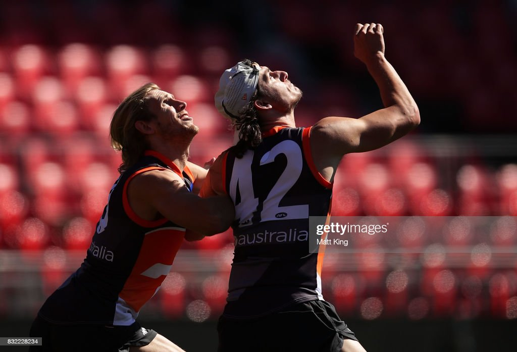 Jake Stein (R) is challenged by Nick Haynes (L) during a Greater Western Sydney Giants AFL training session at Spotless Stadium on August 16, 2017 in Sydney, Australia.