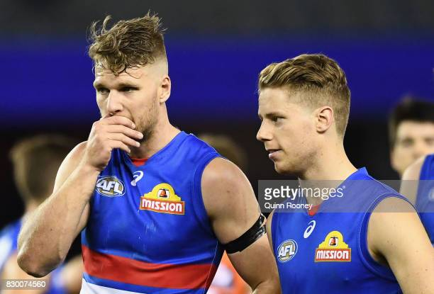 Jake Stringer and Lachie Hunter of the Bulldogs look dejected after losing the round 21 AFL match between the Western Bulldogs and the Greater...