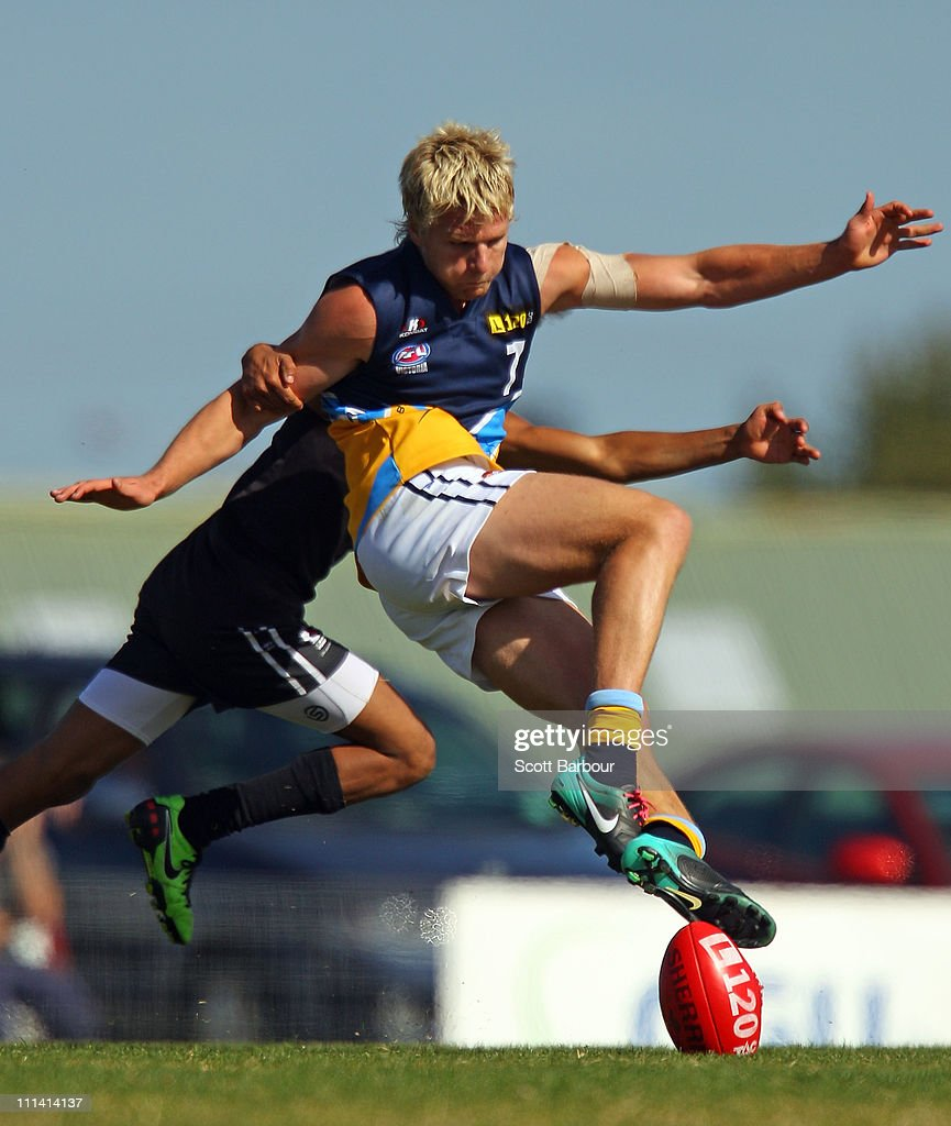Jake Stringer of the Bombers breaks his leg as he is tackled by Jake Neade of the Rebels during the round one TAC Cup match between the North Ballarat Rebels and the Bendigo Bombers at Eureka Stadium on April 2, 2011 in Melbourne, Australia.