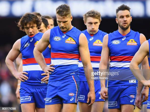Jake Stringer of the Bulldogs and his team mates look dejected after losing the round 15 AFL match between the Western Bulldogs and the West Coast...