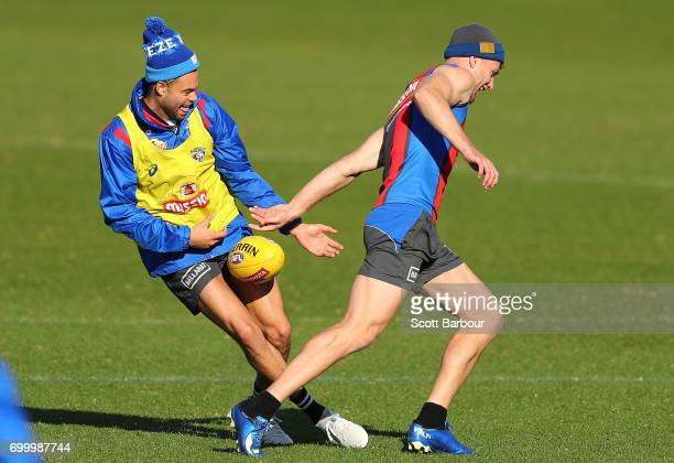 Jake Stringer of the Bulldogs and Jason Johannisen of the Bulldogs compete for the ball during a Western Bulldogs AFL training session at Whitten...