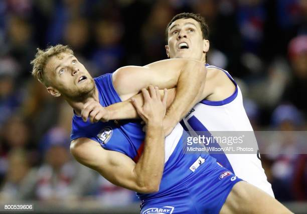 Jake Stringer of the Bulldogs and Scott Thompson of the Kangaroos compete for the ball during the 2017 AFL round 14 match between the Western...