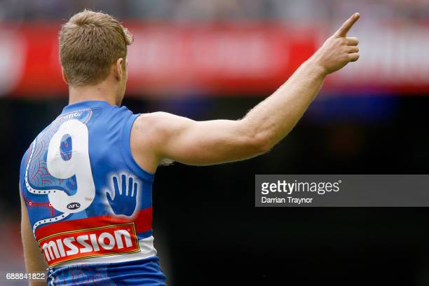 Jake Stringer of the Bulldogs celebrates a goal during the round 10 AFL match between the Western Bulldogs and the St Kilda Saints at Etihad Stadium...
