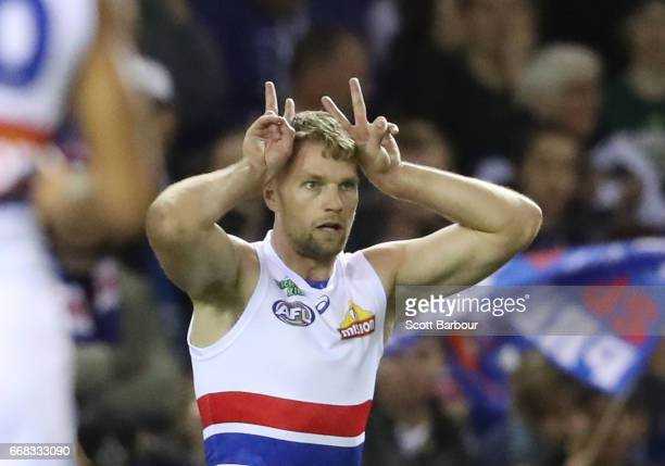 Jake Stringer of the Bulldogs celebrates after kicking the first goal on Easter Friday by gesturing with easter bunny ears during the round four AFL...